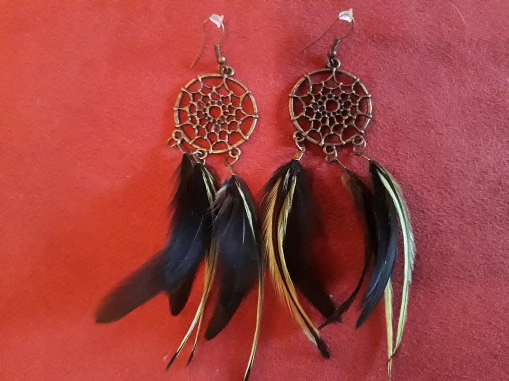 magic earrings feathers